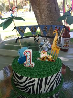 Jungle theme for 1st birthday party smash cake.  All handmade, except for zebra print sugar sheet (used a coupon & got 40% off at Michael's!!)
