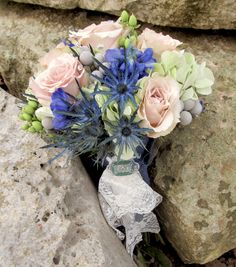 Rustic bouquet of green hydrangea, blue thistle and delphinium, silver brunia berries, green hypericum berries, and quicksand roses.  Flowers by Eden's Echo