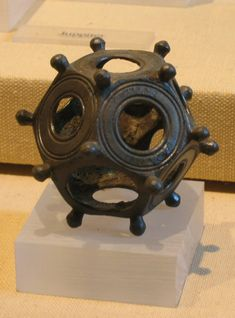 Roman Dodecahedron objects have been found all over Europe – but the mystery continues about their purpose and use. About the only thing that archaeologists have done – is name the objects. They date to around the 2nd or 3rd AD century.