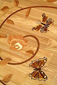 Inlaid, parquetry, and border wooden floors. Also stone and wood medallions and custom designs.