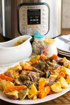 Instant Pot Old-Fashioned Pot Roast with Gravy & Vegetables is the best pot roast I've ever made. This easy, one-pot dinner is a family favorite! . . #potroast #cookbookreview #instantpot