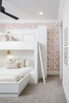Lovely white and pink girls' bedroom is fitted with shiplap built in bunk-beds dressed in soft white and pink bedding accented with French burlap pillows and lit by antique brass sconces. Girls Bunk Beds, Bunk Bed Rooms, Bunk Beds Built In, Cool Bunk Beds, Kid Beds, Custom Bunk Beds, White Bunk Beds, Pink Girls Bedrooms, Build In Bunk Beds