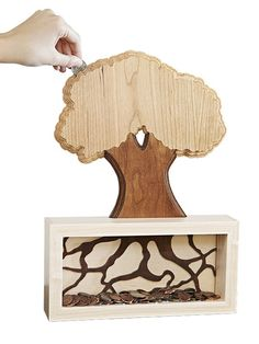 Teds Wood Working Money Tree Coin Bank Woodworking Plan from WOOD Magazine (for purchase) - Get A Lifetime Of Project Ideas & Inspiration! Wood Magazine, Popular Woodworking, Fine Woodworking, Woodworking Furniture, Woodworking Ideas, Woodworking Garage, Youtube Woodworking, Woodworking Joints, Woodworking Patterns
