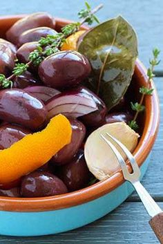 These are amazing! Marinated olives with orange peel, garlic, red onion, herbs and extra virgin olive oil.