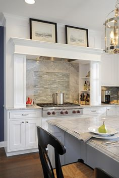 Sonoma Tile Makers Glass mosaic and stone slab backsplash over a Wolf rangetop designed by Stefanie Ciak of J.S. Brown & Co.  Photography by Visual Edge