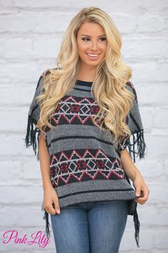 This adorable fringe poncho is such a cozy addition to your wardrobe this season - you're sure to love wearing it all day long!