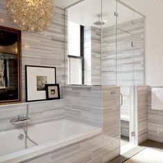 Tile surround, floor to ceiling glass shower, and I love that type of tile