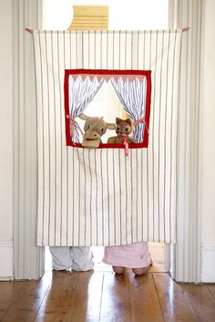 Love this version of a transportable puppet theatre - you could make this out of an old bed sheet and some scraps!  What an awesome gift this would make!