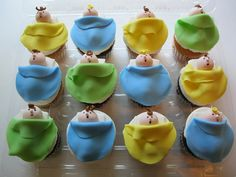 Adorable cupcakes.  They remind me of my mother's nut baby ornaments made from half a walnut shell.