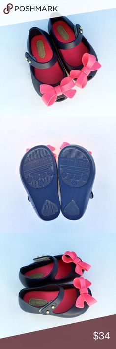 NWOT Mini Melissa Shoes Navy with pink bow. Brand newThese were our first pair of Mini Melissas and I didn't realize how small they run. Worn in the house one time as I squeezed her foot in to try to make them work. They definitely fit more like a four than a five.  Mini Melissa Shoes