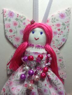 A personal favourite from my Etsy shop https://www.etsy.com/uk/listing/456816748/melody-rose-sparkly-pink-hanging-fairy