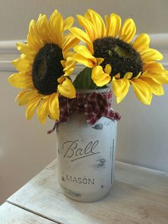Chalk painted mason jar in a neutral color with a wax finish and accented with dried sunflowers.  Jar can be cleaned by using a damp cloth. This item is not dishwasher safe and you should not use any abrasive cleaners on it as the paint will come off.