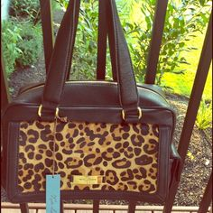 """🆕  Kate Landry Handbag Brand New With Tags Gorgeous Animal Print Kate Landry....Plenty of pockets to store things.  Interior 2 drop in and 1 Zipper.  Exterior includes side Snap pockets and back drop in pocket.  Beautiful Wine Colored Lining.H 8"""" from strap 15"""". W 12"""". Top Seller Kate Landry Bags"""