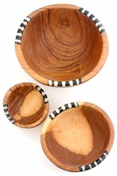 This fun set of small wooden bowls makes a great gift for culinary enthusiasts. Each bowl is hand carved from wild olive wood, a beautiful hardwood indigenous to Eastern Africa, by the Kamba people of Kenya. With care, wild olive wood bowls grow more and more beautiful with age.