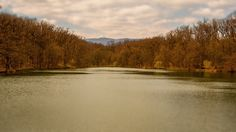 Medvednica hill rising above the peaceful lake in the Maksimir park Zagreb Croatia