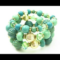 Turquoise Aqua Mint Ocean View Beaded Bracelet Set Gorgeous Colors of Turquoise Aqua Blue and Mint Green with Gold accents and a hint of Rhinestones.  Three Bracelets in this set include two with Larger beads and One with smaller beads.  The larger beads measure 5/8 inches in diameter.  Worn all together they measure 1 3/4 icnhes wide.  Dive in!  Gift Box included. Jewelry Bracelets