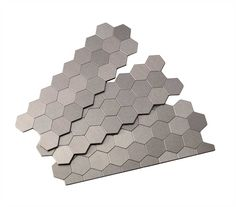 Peel and stick Honeycomb style metal tiles in Brushed Stainless is an elegant and versatile choice. This finish compliments both cool and warm tones and brings distinction to any home décor.  (Includes 3 sections or about 1 square foot)