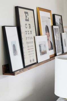 Three simple pieces of wood nailed together create a fabulous display for photos and art. Call you can even have the wood cut to size at Home Depot. Cost under $25