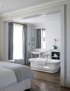 Richard Powers Photography blue & gray elegant open master bathroom design with freestanding soaking tub, white pedestal sink, fireplace and blue silk drapes. Open Bathroom, Master Bathroom, Bedroom With Bathtub, Bathroom Grey, Bathroom Closet, Bathroom Layout, Dispositions Chambre, Bedroom Layouts, New Homes