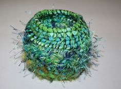 Sarah Bell Smith - A coiled basket I made using fabric strips, wool and hand stitching.