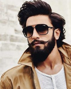 What is beard oil and beard balm and what do they do? Learn the differences between them as well as other beard products like beard lotion and beard spray. Ranveer Singh Hairstyle, Ranveer Singh Beard, Beard Styles For Men, Hair And Beard Styles, Long Hair Styles, Beard Oil And Balm, Beard Balm, Mustache Growth, Men Fashion