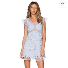 Lace Periwinkle Garden Dress Periwinkle lace knit dress with mesh panels in size XS. I am normally a Small sized down for this for a better fit all over. Has a side zipper that is hidden. Worn once for only a few hours, in perfect condition. Can post photos of actual dress. This size is consistently sold out online!! JOA Dresses