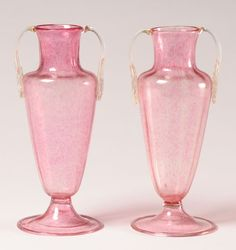 Pair Salviati Murano pink art glass vases; applied foliate form handles with gold inclusions.