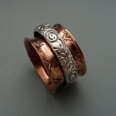 Copper And Sterling Silver Spinner Ring by AdornmentsByMuyiFabu on Etsy https://www.etsy.com/listing/503678953/copper-and-sterling-silver-spinner-ring