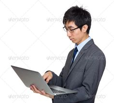 Asian businessman type on laptop computer ... asia, asian, background, boss, business, businessman, chinese, communicate, computer, concentrate, confident, corporate, digital, electronic, executive, eye, formal, glasses, hand, handsome, hold, isolated, japanese, korean, laptop, look, male, man, manager, media, notebook, officer, one, pad, portable, portrait, profile, read, screen, serious, side, smart, social, suit, take, touch, type, use, wear, white