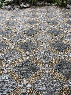 Depth in the texture of floor pattern shown in the alignment of the stone pebbles laid out in different directions of the pattern shapes. Shape in the pattern is repeated throughout.