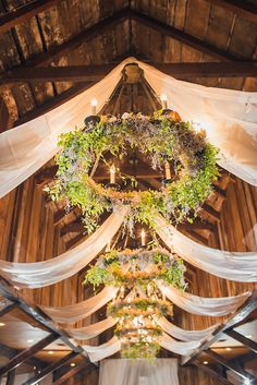 Hula hoops with lighting & material draped Wedding chandelier# rustic# barn# country# wedding decor Chandelier Wedding Decor, Flower Chandelier, Barn Wedding Decorations, Hula Hoop Chandelier, Chandelier Ideas, Barn Wedding Flowers, Chandeliers, Floral Wedding, Hanging Flowers Wedding