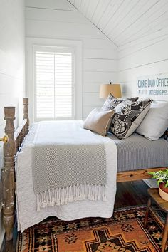 Love this! The bedding, sign, & beautiful rug!