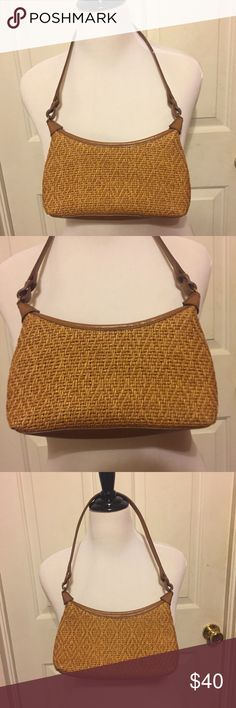 Fossil Straw & Tan Leather Purse/Handbag Fossil Straw & Tan Leather Purse/Handbag. Rare. Has tan leather strap and bottom. Has one extra interior compartment that zips inside. The only imperfection is a slight scratch on the strap as pictured. Not noticeable. Comment if you need measurements. Bundle and Save $ Fossil Bags Mini Bags