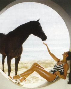 Nati Abascal,Marchioness of Villaba, and her black stallion, Idle Ruler, Barbados; photo by Norman Parkinson, 1982