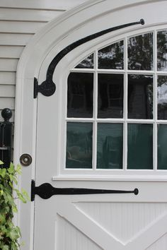 These are Beautiful Carriage Style Garage Doors, will add so much charm to exterior!     Amy Meier Design - Martha's Vineyard carriage door inspiration