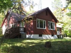 MLS # 148259 - If you seek a peaceful setting, on a lake where fish are plentiful and the forest is filled with wildlife...then this is the spot for you. This unique home and property, with frontage on TWO lakes, is surrounded by a forest of hardwoods and pine.