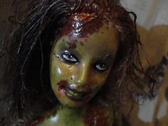 """Facial Close Up This doll is: A Unique One of a Kind Zombie Makeover by Medina  Formerly 12"""" 1999 Barbie Fashion Doll A Very Unique OOAK Artist Collectible Doll Artist's inspiration:  #TheWalkingDead #ResidentEvil #ZombieLand #ShaunoftheDead #Dawn of the #Dead #Night of the #LivingDead #28 #Days #Weeks #Later #Left4Dead"""