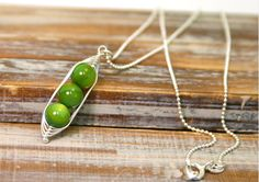 """I love this little """"peas in a pod"""" necklace, especially since I had 3 little peas in my pod at the same time. ;)"""