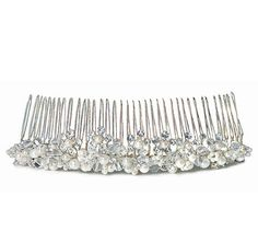 White Pearl & Crystal Flowers in Silver Hair Comb is the perfect finishing touch to your bridal hair style. Bridal hair comb features beautiful white pearls and sparkling crystals and will add the finishing touch to the bride's ensemble.