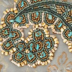 This is a Bead Embroidery Project on Fabric. The Focal Bead is an Original Artwork Reproduction in Resin. The Mixed Media Piece was featured in Cloth Paper Scissors January/February 2011 magazine. Thi