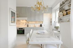 White & grey calm kitchen, would have chosen a different lamp though
