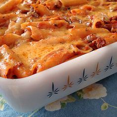 Penne Pasta Casserole Recipe Main Dishes with pasta sauce, yellow onion, olive oil, minced garlic, penne, basil leaves, shredded cheddar cheese, ground beef, sugar, pepper, salt