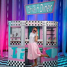 This 1950's Diner Prop is the must-have prop for your fifties themed party with the look of a diner and the sound of a fifties song!