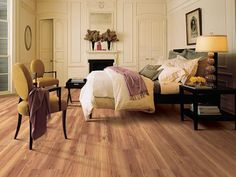 Traditional Bedroom With Laminate Flooring