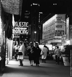 A night street scene at 47th Street near Times Square, showing night club and theater signs, New York City, New York, circa 1958. (Photo by /Getty Images)