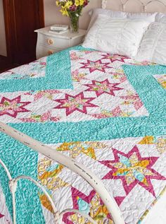 How do you make traditional quilt blocks into a contemporary quilt? Set them in a unique setting with trendy colors like this aqua print in Lightning, by Michelle Renee Hiatt! Get the quilt kit while supplies last!