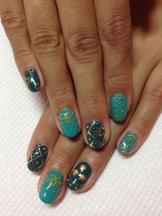 Teal and Turquoise and Gold Stud nail art manicure.