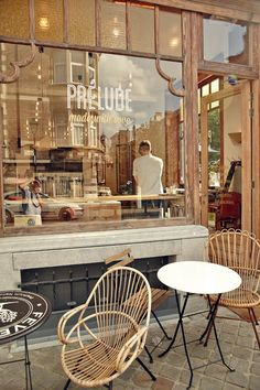 "Le Prélude ""... beautiful place. Ground floor with hight ceilings, duo of cream shades on the walls, wooden lamps by Hopop Studio and Géraldine Calbert, comfy cushions, and a terrace that goes all the way onto the grass. A day place, where you can enjoy breakfast, lunch, pastries in the afternoon or even drinks to begin the night..."""