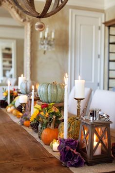 Pumpkins on pedestals, lanterns and and gorgeous blooms in mason jars - 7 stunning tablescape ideas for Thanksgiving