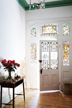 Green painted crown moulding - White walls and original stained glass in a older home